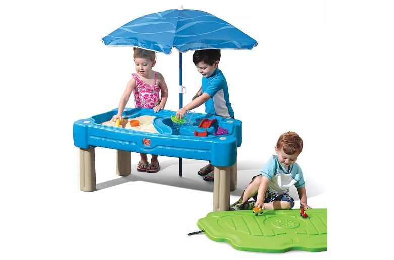 Water table from Step2 Cascading Cove Sand & Water Table with Umbrella showing three kids
