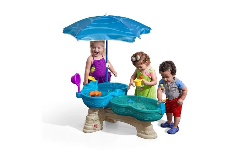 Water table from Step2 showing three kids with an umbrella