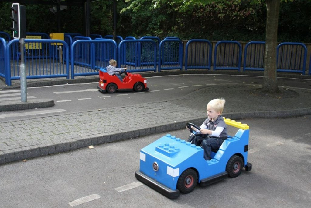 2 kids in a ride on toy car