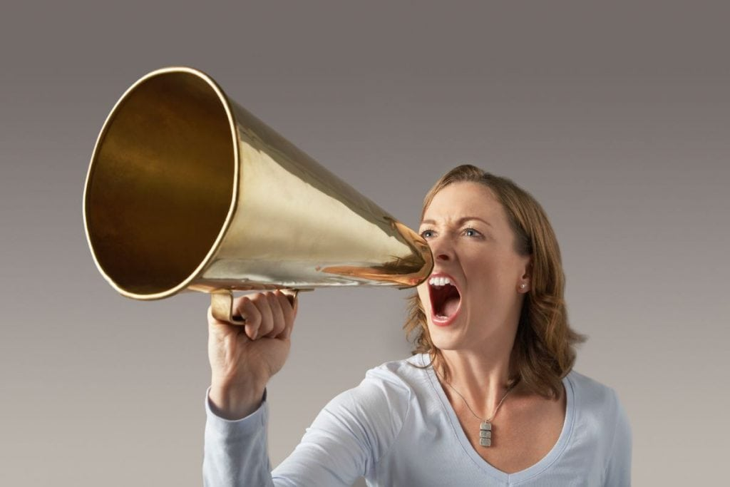 A woman screaming into a loudhaler