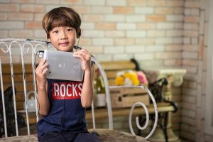 child with tablet and headphone