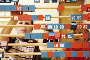child playing on abacus
