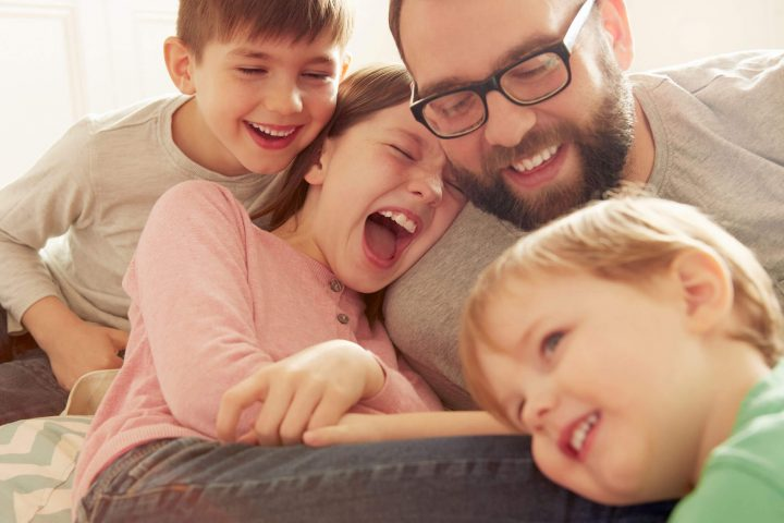 Father laughing with his children