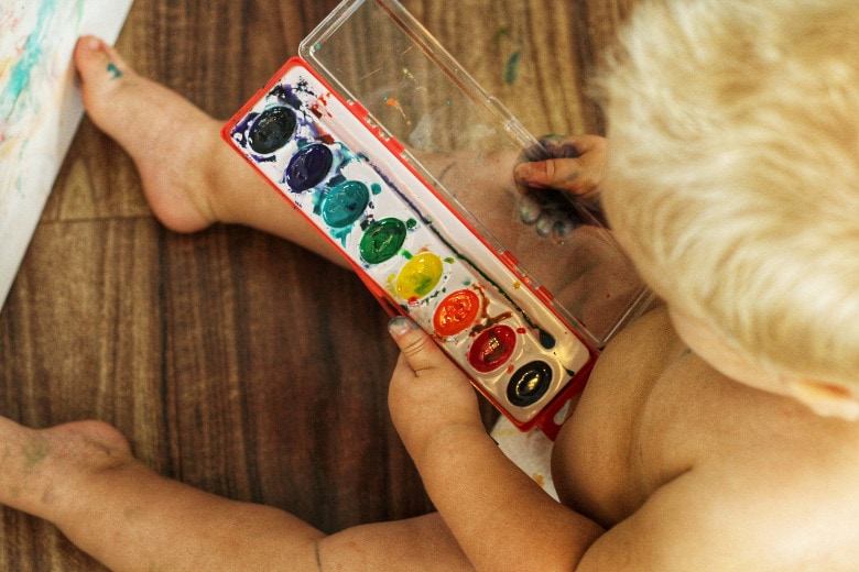 A child playing with paint