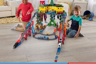 Kids playing with colorful train set
