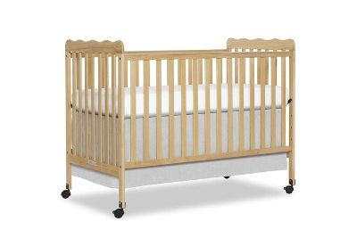 Cream crib for toddlers and babies