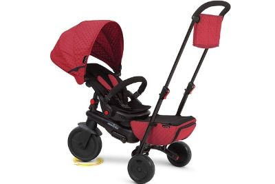 Red and white tricycle for babies and toddlers