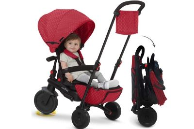 Baby on a red and black tricycle