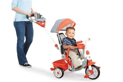 Mom pushing baby on a tricycle