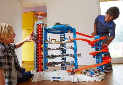 Kids playing with a blue and red garage toy