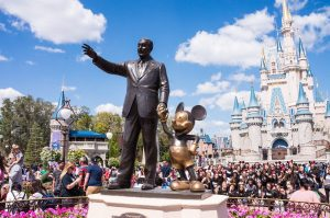 Statue at Disney holding Mickey Mouse' hand