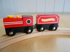 Red train on a wooden track