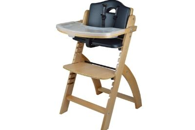 Wooden highchair with black seat and a tray