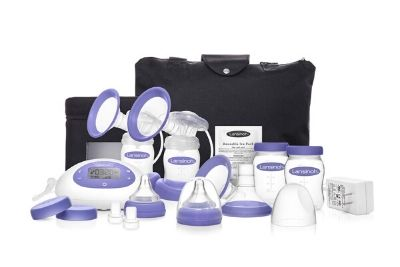 Purple and white double breast pump with black bag and milk bottles