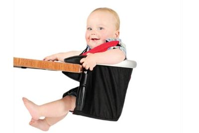Baby sited on a black clip-on highchair