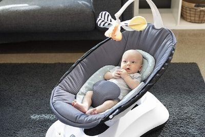 Baby sited on a reclined infant swing