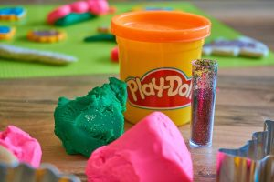 Pink and green play doh and glitters