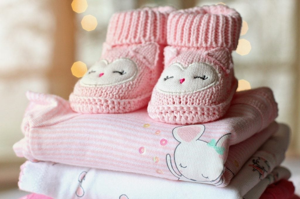 Pink receiving blanks and pink crotchet baby shoes