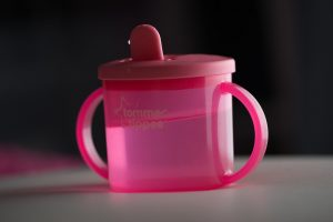 Pink sippy cup for toddlers and babies