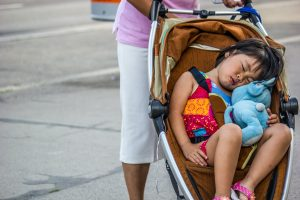 Little girl sleeping in travel system