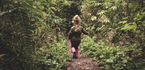 Child walking alone in the forest