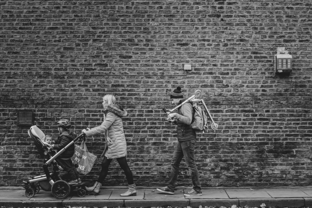 family walking with sit and stand stroller