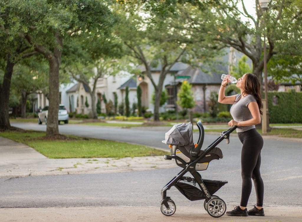 Mother exercising with her stroller