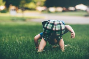 Active toddler playing on grass