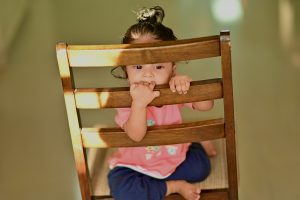 Young child sitting on chair