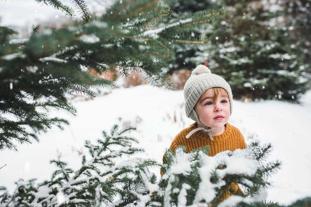 Baby with snowfall around him