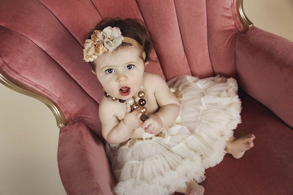 Baby Girl on Sofa - featured image