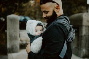 Father carrying his baby in a baby carrier