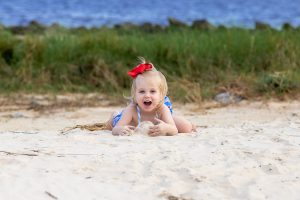 Baby playing on sand