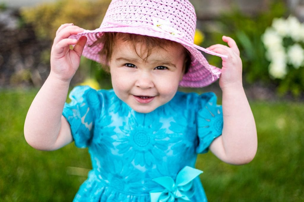 Baby with pink hat