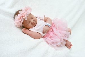 Baby girl sleeping wearing pink clothes