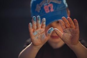 Baby's hand with paint
