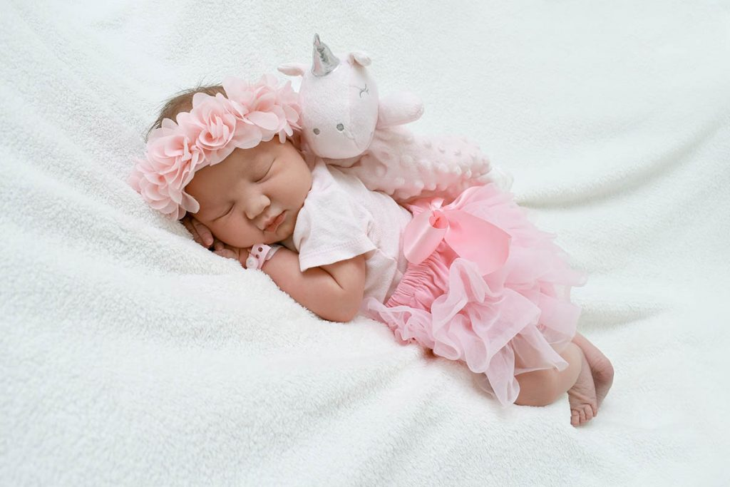 Sleeping baby with a small bear