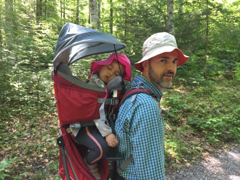 Balint with deuter backpack and a child sleeping