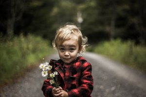 Boy holding some flowers