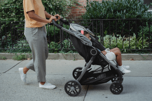 Father holding his son in stroller
