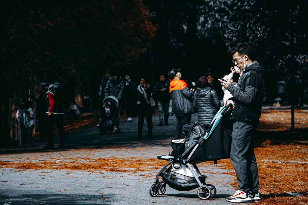 Father with his baby on the street