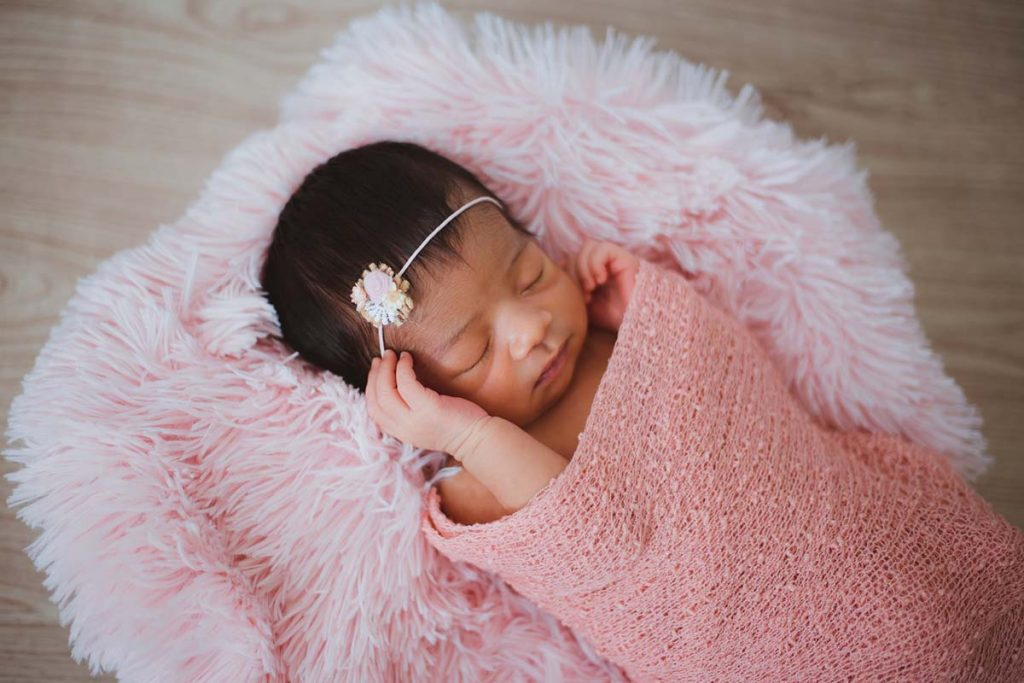 Born baby in pink blanket