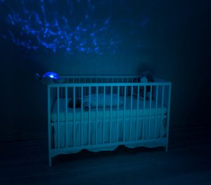 Child sleeping in a crib at night