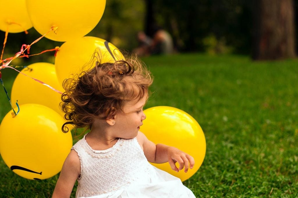 Baby photoshoot with yellow balloons