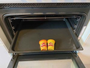 Play Doh in an oven tray